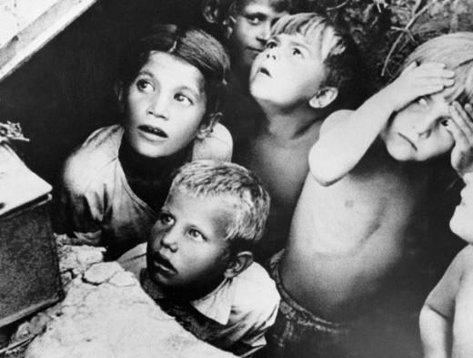 Children during air raid : Soviet children during a German air raid in the first days of the war.(near Minsk,Belorussia)