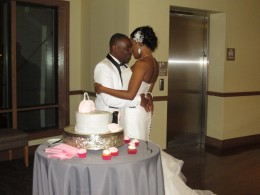 Darlena and Raymond, gather before the cutting of their cake.
