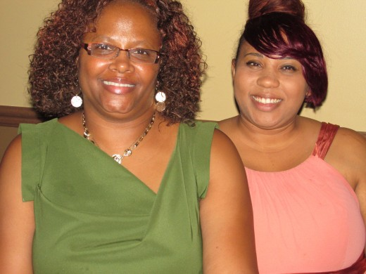 Choya and her daughter Kenya, also enjoy the events at the reception.