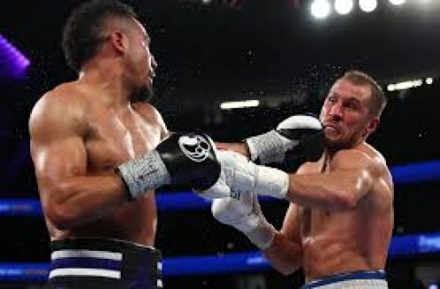 Andre Ward survived a knockdown and heavy pressure to comeback and win a razor close 12 round decision over light heavyweight king Krusher Kovalev to claim the crown.