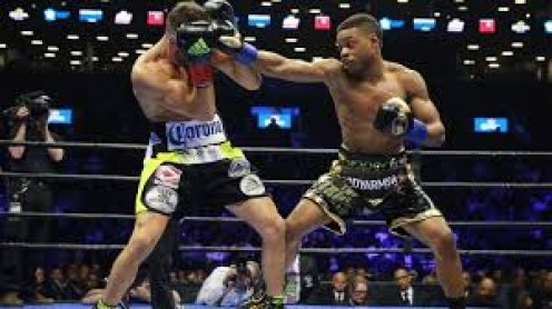 Errol Spence proved to have power to go along with his skills when he stopped Chris Algeri in a welterweight match.