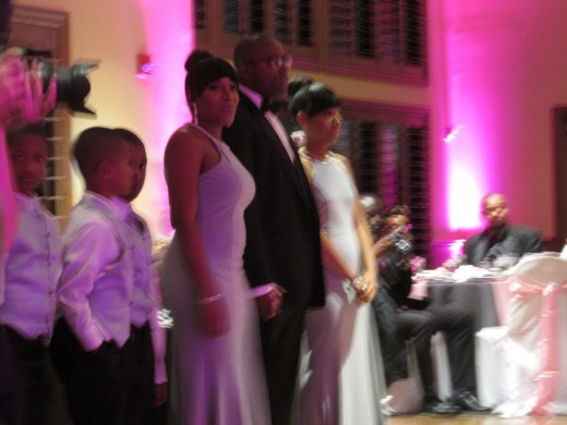 The bridal party gather at the reception before entrance of bride and groom.