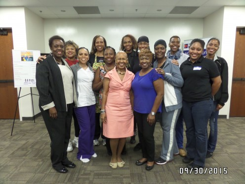 Rev. Sandy with Wholistic Women Wellness guests and SisterLove's representatives. With House Rep. Mabel Thomas (in the black pants suit).