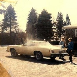 This is a photo of us washing our father's car, but look to the front and see the ghost of the kid that was shoot right on our property in the early Seventies! It's a ghost.