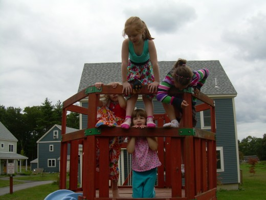 My daughter having spontaneous, unplanned fun with friends at our playground