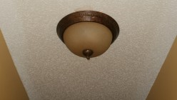 Can someone tell me how to replace the bulb in this fixture? I'm not sure how to dismantle it.