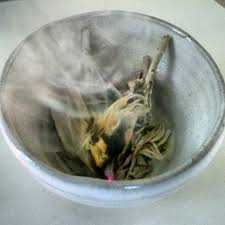 You can use a small clay pot or an abalone shell to set your smoking sage bundle in (though it's not required)