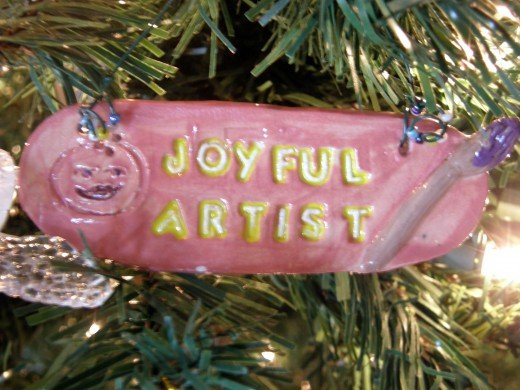 The author is an Artist, and this ornament of clay represents that.