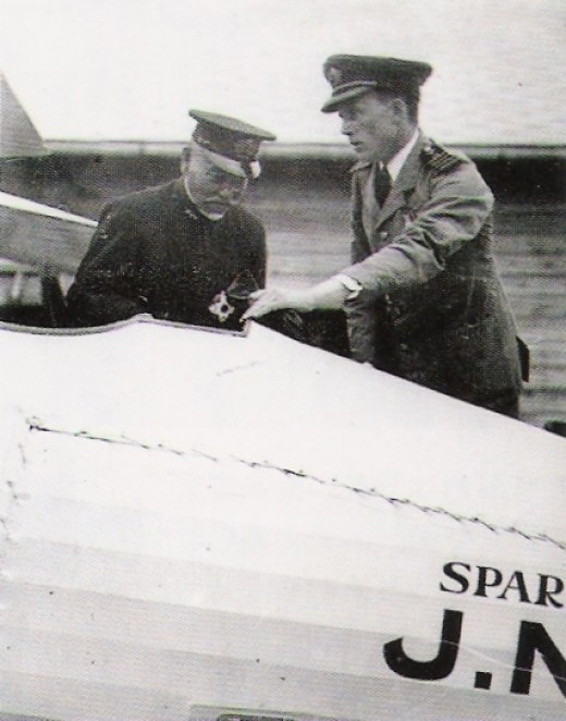 Sempill points out a technical feature to an officer of the Japanese Navy