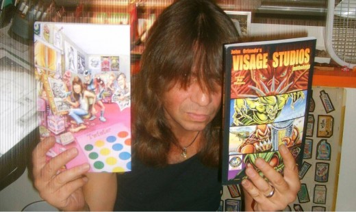 John Orlando showing off his latest comics.