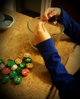 My son unwrapping the chocolates.