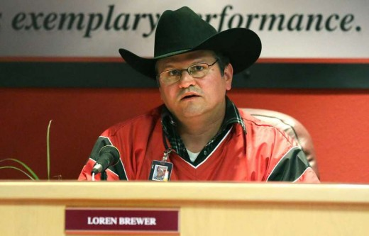 Loren Brewer,  mismanaged funds and his authority.