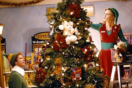 Here is Jovie's costume from the movie Elf.  She is wearing a red dress with a green shirt underneath and a green belt.