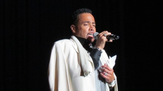 Morris Day, returned to the stage dressed in a white coat after a brief break.
