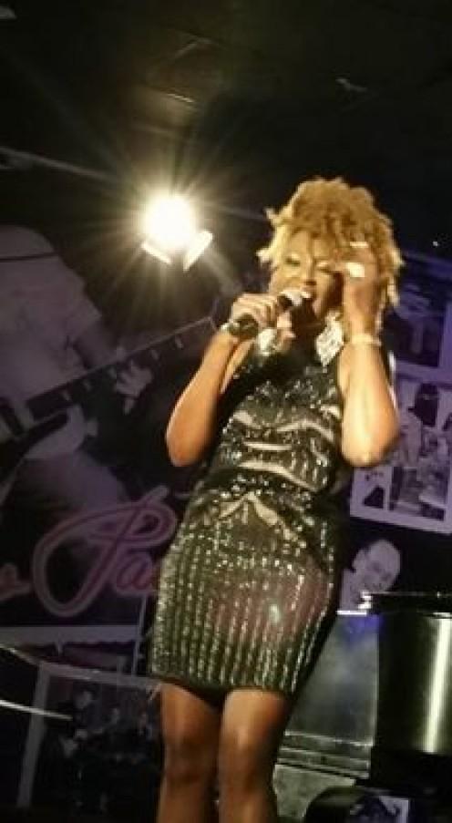 Aziza performing at the Iridium in NYC.