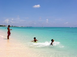 The author's children frolicking in the beautiful waters on Seven Mile Beach, Grand Cayman.