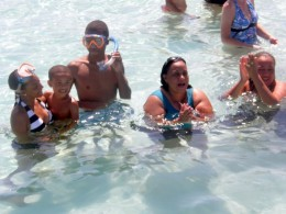 The author with her children, and childhood friends at Sting Ray City, Grand Cayman.