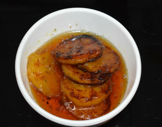 shallow fried plantains in sugar syrup