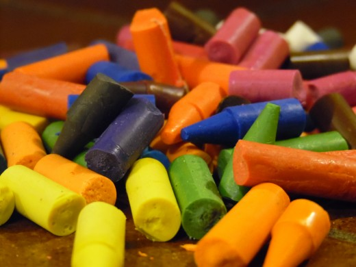 Don't grind them down into a fine powder. Break up your crayons into 1/4 to 1/2 inch pieces.