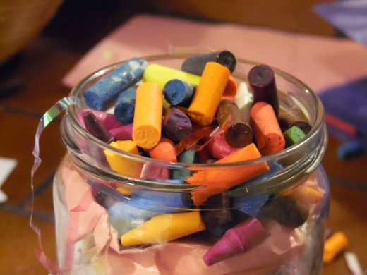 Keep pressing down your layers to make room for more crayons and that final layer.