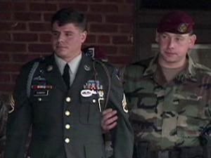 Army Staff Sergeant being escorted from a Court Marital hearing