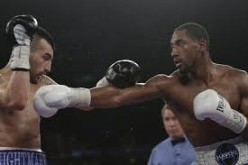"""""""Boo Boo"""" beat Vanes Martirosyan by 12 round decision to claim the WBO junior middleweight world title."""