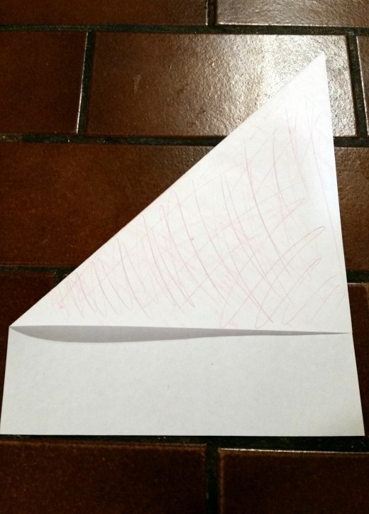 Line up your corner parallel with the opposite side of the paper then fold.