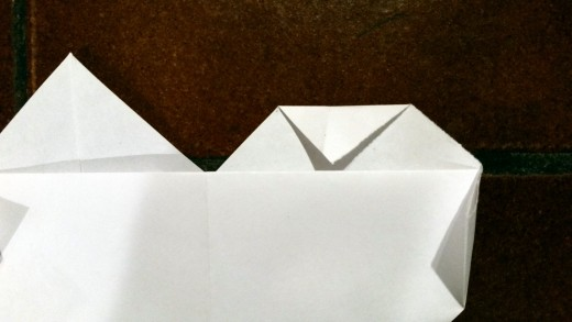 As you fold the top corners down, make sure the tips of those corners touch the edge of the fold line pictured above.