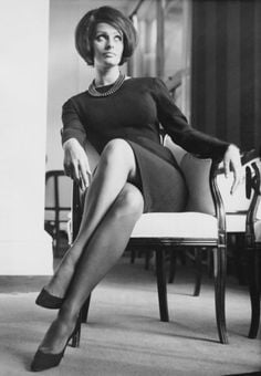 Sophia Loren rocking a sleek shift and statement necklace.