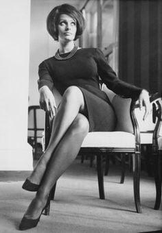 Sophia Loren rocking a sleek shift and statement necklace.