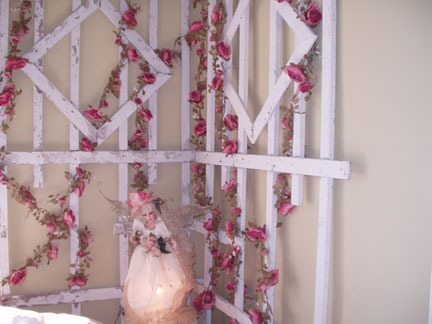 The rose trellis from the front porch, decorated with silk rose garlands.
