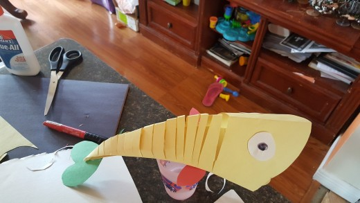 fish for my sons first birthday. Hang a string from the center and it bobs and moves with the air in your house.