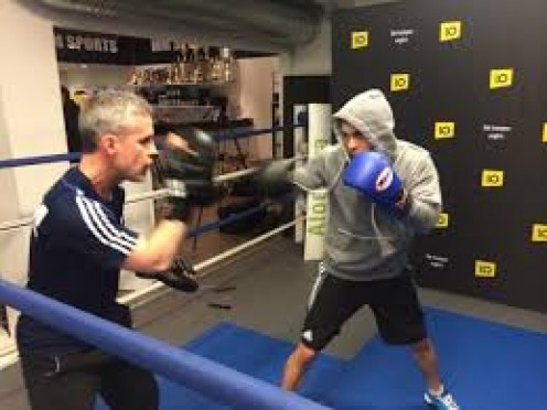 Joey Gamache, left, now trains fighters and does a solid job. Gamache is the former junior lightweight/super featherweight and lightweight champion.