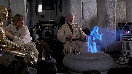 C3PO, Luke Skywalker and Ben Kenobi watching Princess Leia's message, delivered by R2D2