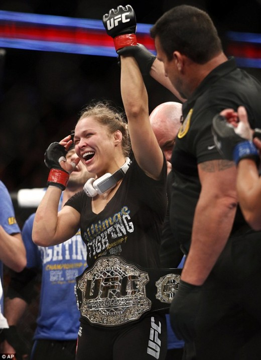 Ronda Rousey, celebrates her win against Liz Carmouch
