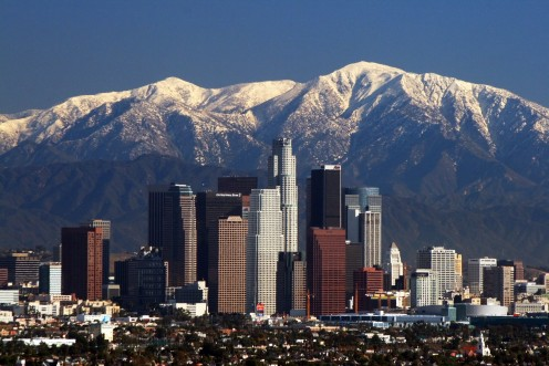A view of the Los Angeles Skyline overlooking the mountains which are in the background.