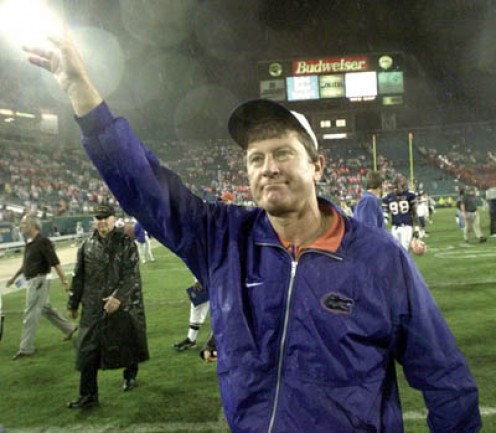 Then-Florida Gators head coach, Steve Spurrier waves to Gators fans as he leaves The Swamp after another victory by The Gators