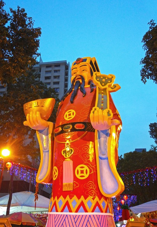 A huge Cai Shen, or Chinese God of Money, welcomes shoppers to the Waterloo Street festive market.