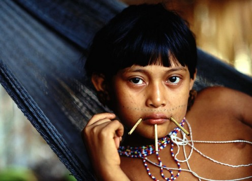 Yanomami Girl in traditional attire and decorative accessories.