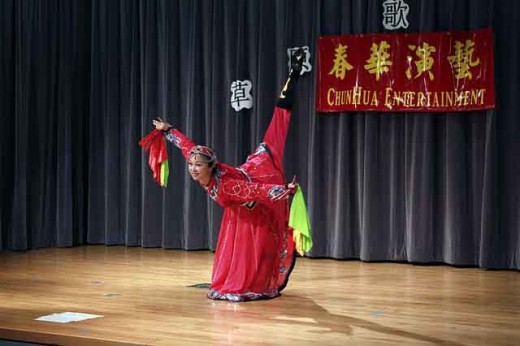 Asian performer demonstrating her skills as a dancer.