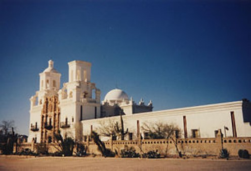 The sheer size of the mission with its white stucco makes it a grand sight from a distance (The White Dove of the Desert)