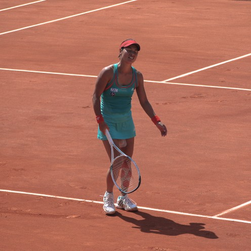 Japan's Kimiko Date-Krumm reacts after losing her 1st round match at the 2012 French Open.