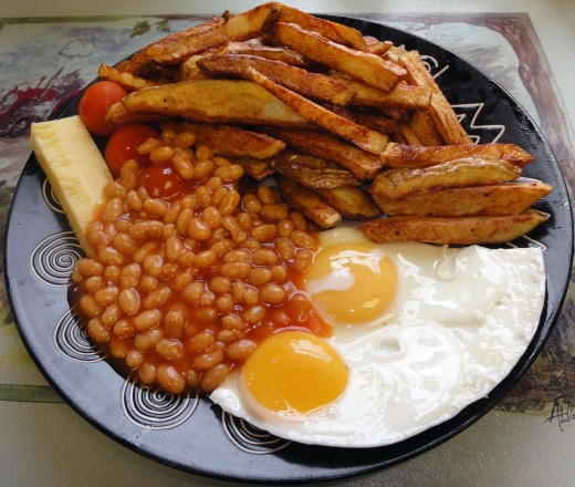 British egg and chips, served with baked beans, cheese and tomatoes.