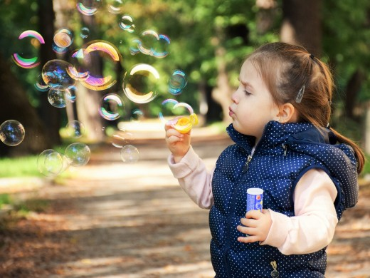Children love blowing soap bubbles. This play activity provides hours of fun and color.