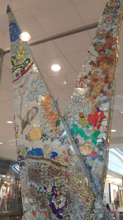 Polo Park Mall in Winnipeg.  Tall scissors made by a local school.  Art teacher could ask kids what they see.  Recycling could be the answer.