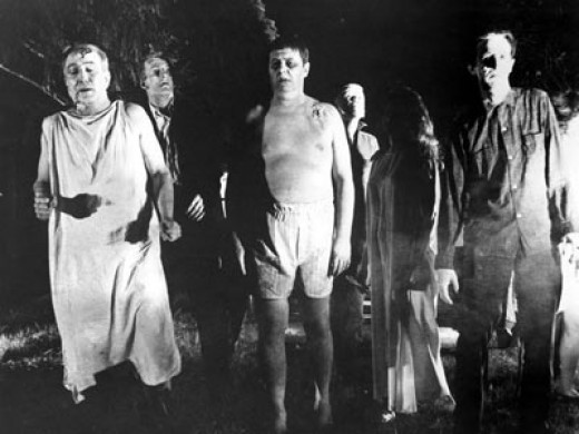 Zombies stalking the countryside in Night of The Living Dead