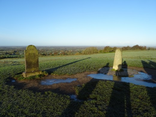 Atop the Hill of Tara, you can find Stone of Destiny (right) and the monument from the eighteenth century (left).
