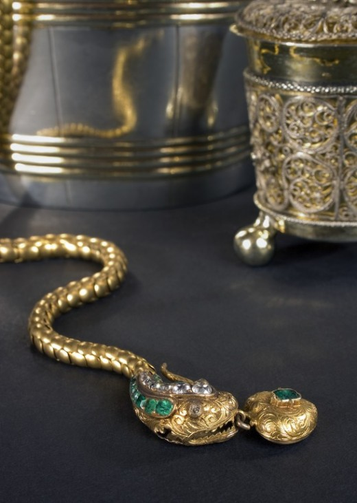 A gold necklace with emeralds and diamonds. When clasped the snake is biting its own tail. There is no hallmark and so valuation is difficult.
