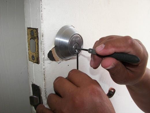 Unlocking a door.