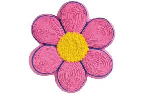 This daisy cake has hot pink and yellow icing. It was made with the Wilton pan shown below. Perfect for your hippie party.